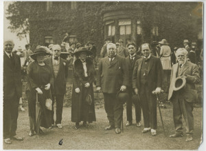Frank Kidson pictured at an unknown event in the 1920's with a group of as yet unidentified people.